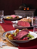 Roast beef with beetroot relish, roast potatoes and cucumber for Christmas