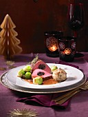 Pink beef fillet with prunes, bread dumplings and brussels sprouts (Christmas)