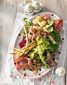 Salad with parsnips, bacon, grapes and walnuts (South Tyrol)