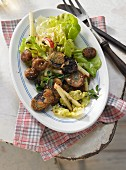 Lettuce with glazed chestnuts and fried sausages (Austria)