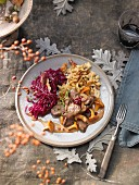 Beef stew with red cabbage and walnut spatzle (Switzerland)