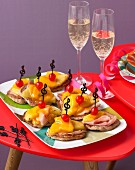 Mini Hawaiian pizzas and sparkling wine for a retro party