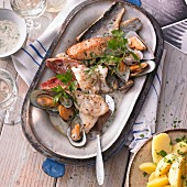 Fish and mussels with parsley potatoes