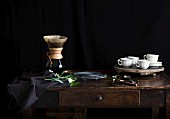 Filter coffee and cups and saucers on a sideboard