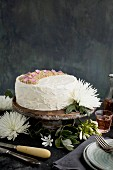 A marzipan almond cake with orange blossom mascarpone frosting