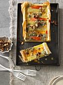 Kartoffel-Kürbis-Tarte mit Gorgonzola und karamellisierten Cashewnüssen