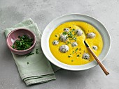 Carrot and ginger creme soup with veal balls