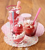 Raspberry ice cream with meringue pieces in a glass