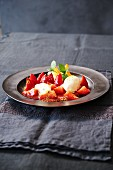 Strawberries romanoff with vanilla ice cream