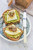 Toast with avocado cream and fried eggs