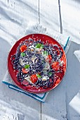 Black spaghetti with squid and tomatoes