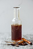 Homemade cola syrup in a bottle
