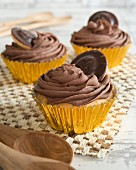 Cupcakes with chocolate cream and jaffa cakes