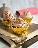 A cupcake decoration with coffee cream