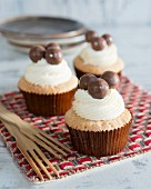 Cupcakes with cream and chocolate balls