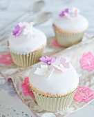 Cupcakes with a fondant glaze and sugar butterflies
