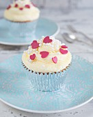 Cupcakes with buttercream and red sugar hearts on the top