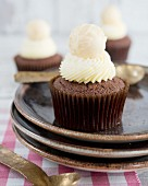 Chocolate cupcakes with a white chocolate praline on the top