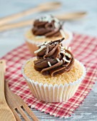 Cupcakes with chocolate cream and sprinkles on the top