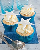 Cupcakes with cream and a starfish on the top