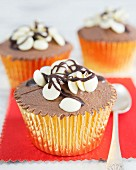 Cupcakes with chocolate cream and white chocolate chips