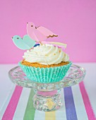 Cupcakes with buttercream and paper birds
