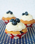 Cupcakes with buttercream and blueberries