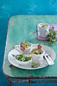 Wild herb soup with daisies and crispy bacon