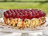 Sponge cake with raspberries, vanilla cream and roasted almond flakes