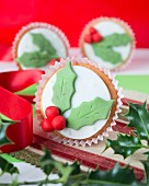 Christmas cupcakes with holly icing