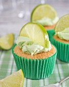 Cupcakes with lime cream frosting and a slice of lime