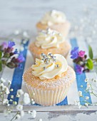 Cupcakes with buttercream and silver pearls