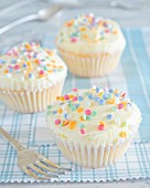 Cupcakes with buttercream and sugar confetti
