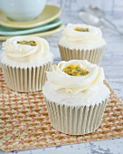Cupcakes with buttercream and passion fruit sauce