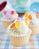 Cupcakes with animal figures and jelly sweets