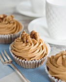 Cupcakes with buttercream and walnuts