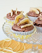 Chocolate cupcakes with sliced banana on the top