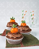 Chocolate cupcakes with marzipan pumpkins