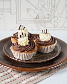 Cupcakes with chocolate cream and chocolate curls
