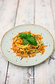 Vegetable spaghetti with pesto and basil