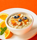 Oatmeal with apricots, blueberries and flaked almonds