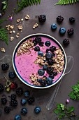 Blueberry and blackberry smoothie bowl with muesli