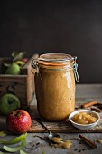 freshly made apple sauce with cinnamon in a jar
