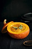 Cream of pumpkin soup served in a hollowed out pumpkin