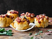 Pizza cupcakes with salami, pepper and mushrooms