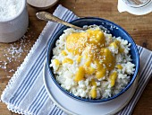 Coconut rice pudding with mango and banana puree