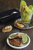 Courgette and salmon fritters with sesame seed bread and salad