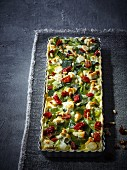 Leek quiche with feta, sun-dried tomatoes and pine nuts