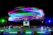 Funfair ride in motion