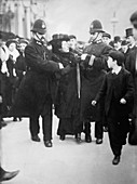 Suffragette being arrested, London, UK